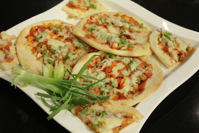 Pita Pizza recipe by Zubaida Tariq. This delightful Ramadan Recipes recipe of Pita Pizza can be ready in approximately 30 Minutes and good to serve around 2-4 People. Follow all the steps recommended by Chef to get a perfect dish.