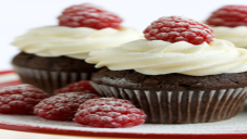 Cupcakes with Vanilla Frosting and Raspberries